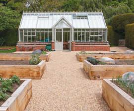 Ground reinforcement system for vegetable garden paths
