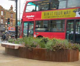 Bespoke corten steel planter-benches for public realm