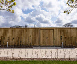 Enclosed shelters with green roofs for Fujifilm offices
