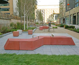 Concrete, modular seating for residential play area