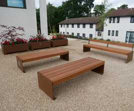 Corten-effect seating and planters for boarding school
