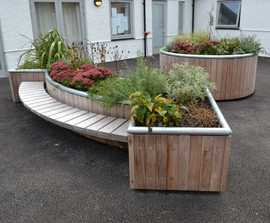 Planters with integrated seating